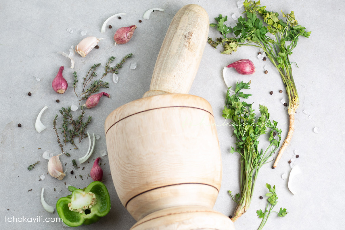 The wooden mortar and pestle is at the center of Haitian cuisine.   tchakayiti.com