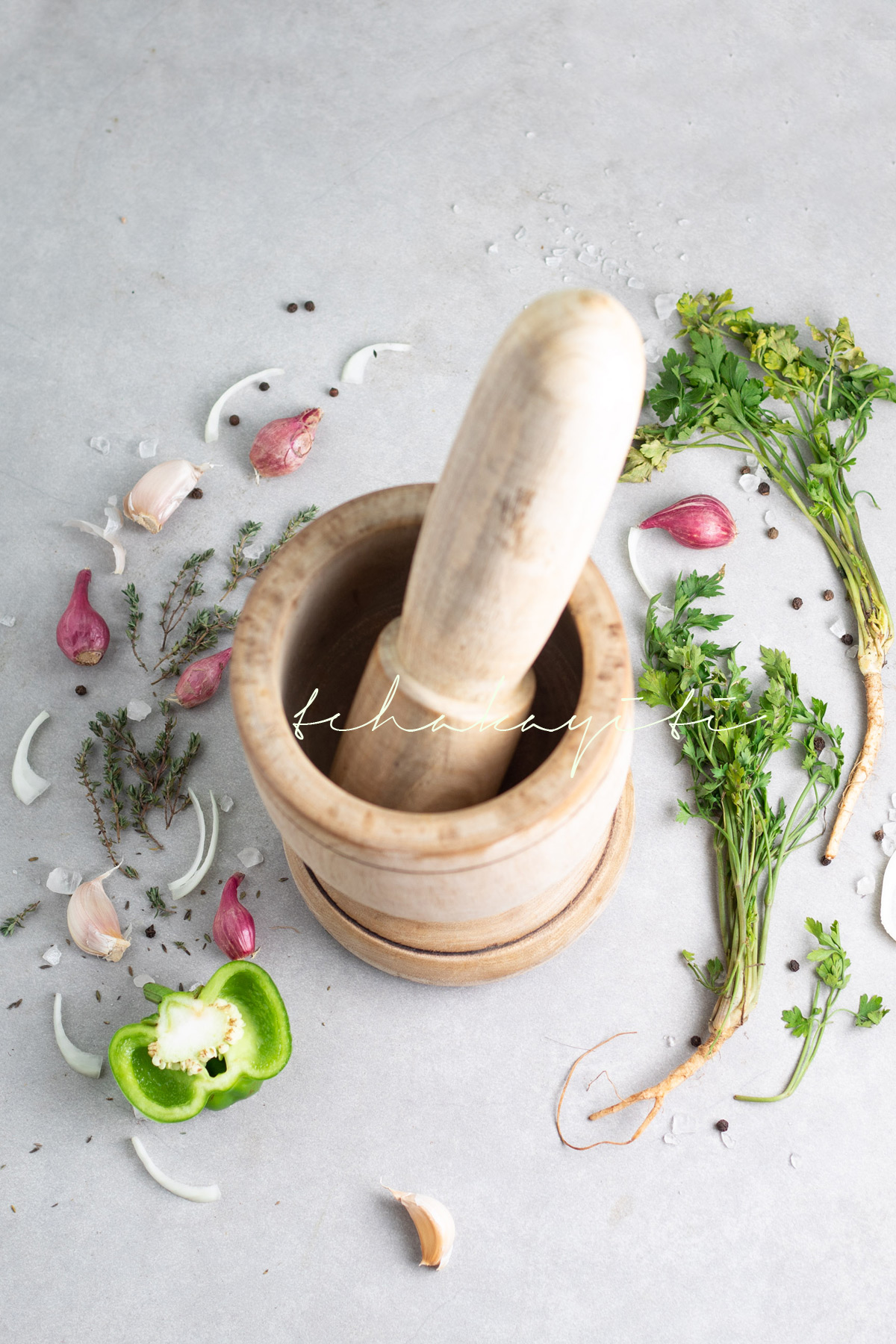 The wooden mortar and pestle is at the center of Haitian cuisine. | tchakayiti.com