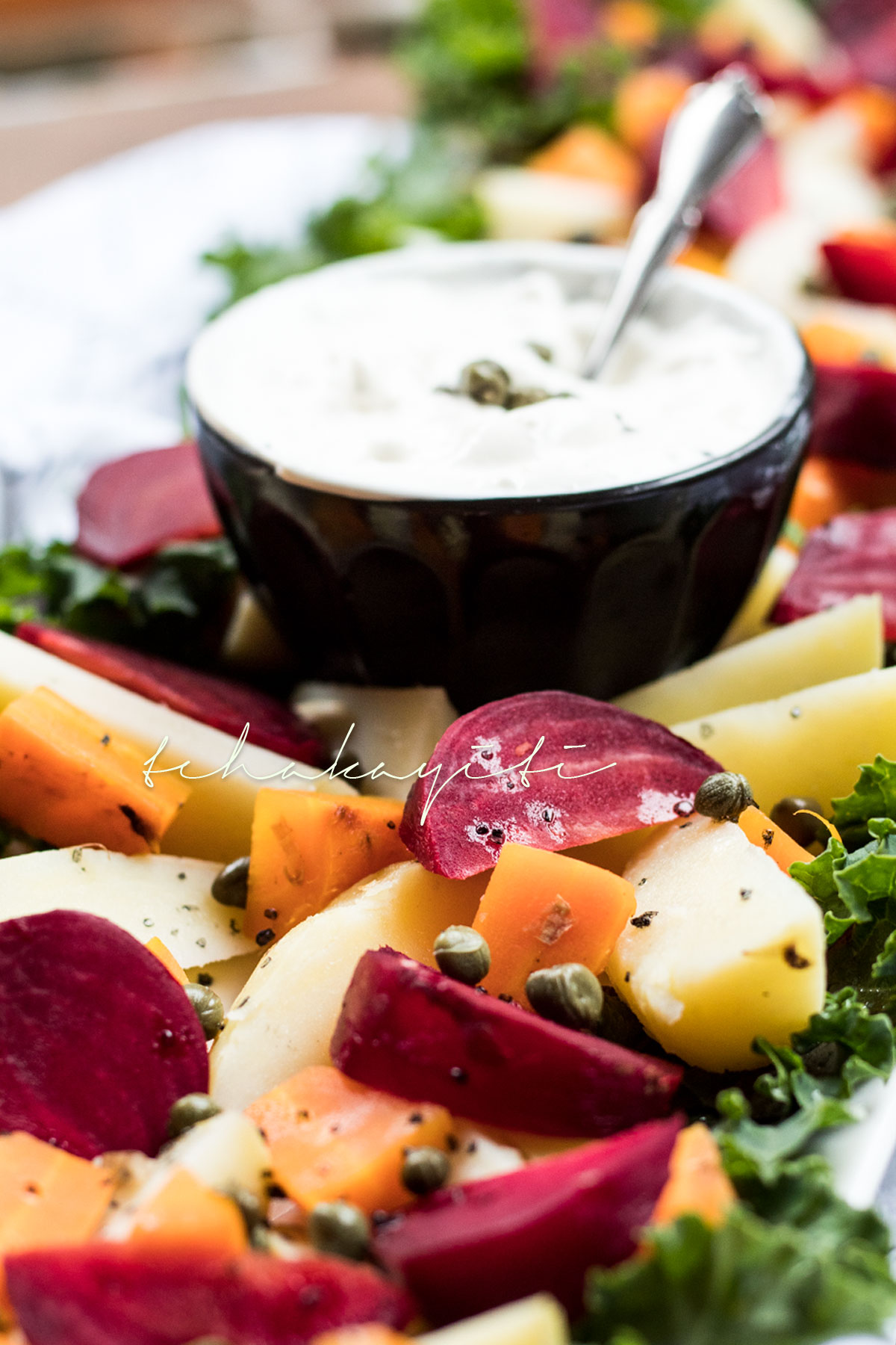 Salade russe is a mixture of potatoes, carrots and beets that are smothered in mayo. A simple and easy salad. | tchakayiti.com