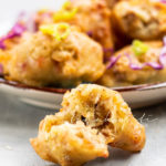 These Haitian chicken marinades are well-seasoned beignets infused with chicken flavors and filled with shredded chicken/. They're the perfect appetizer.   tchakayiti.com