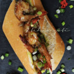 You'll love this spicy grilled shrimp sandwich with caramelized bacon and a spicy rum glaze. | thcakayiti.com