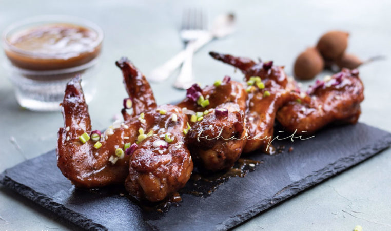 These sour tamarind wings are juicy, sticky, sweet, sour, tangy, they're perfect. You should give them a try. | tchakayiti.com