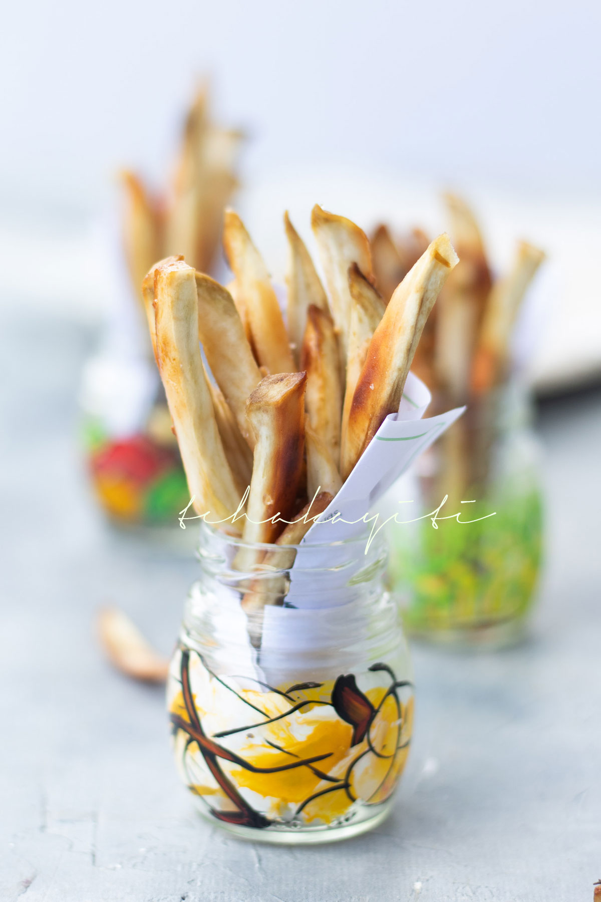 These oven baked Haitian fries are seasoned with salt, pepper and fresh garlic. | tchakayiti.com
