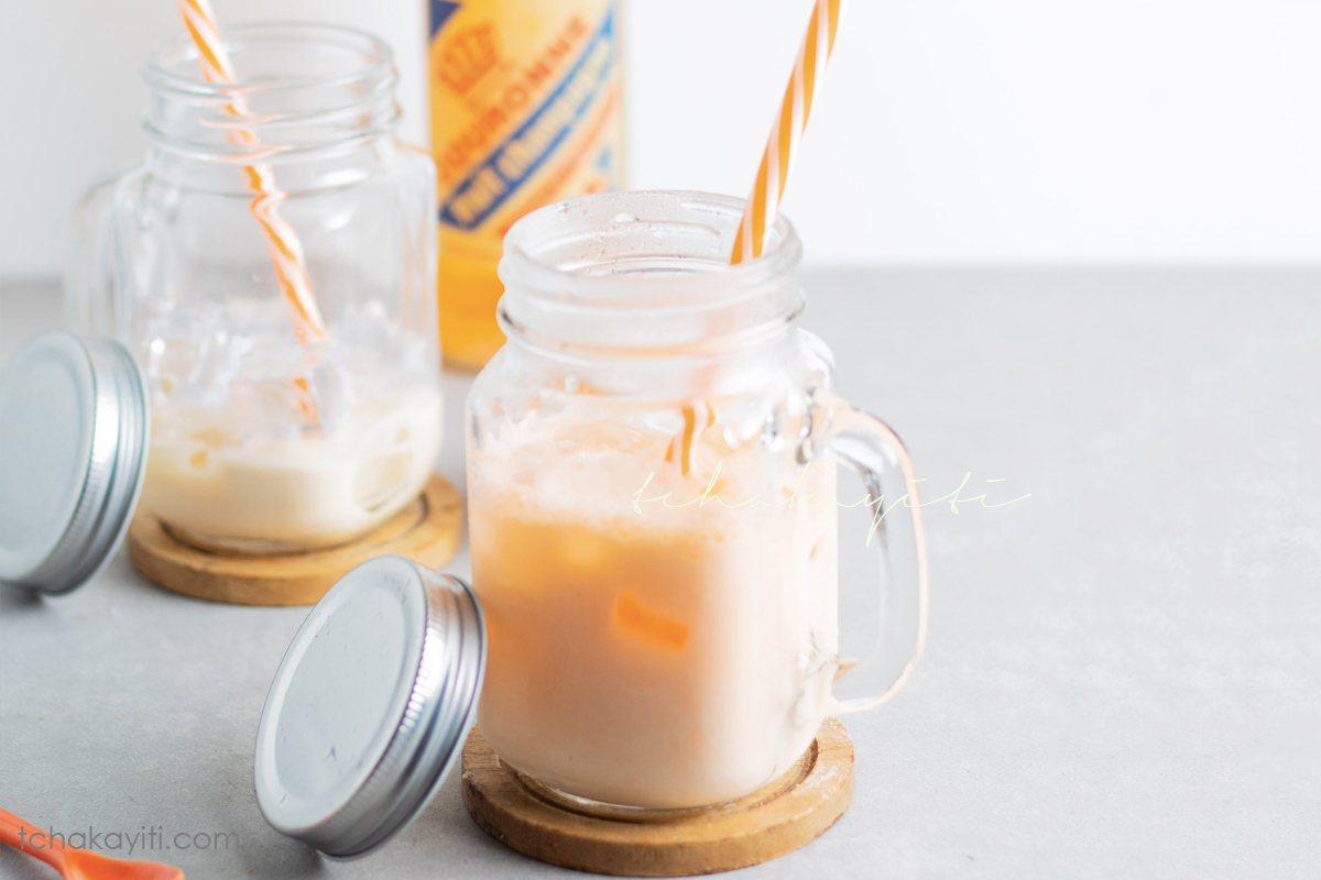 This milk soda is a favorite among many Haitian children. It is a mixture of a local fruit champagne soda and milk.   tchakayiti.com