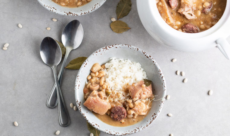 This Haitian-style cassoulet is packed with flavors of homemade salt-cured pork and smoked meat chunks. | tchakayiti.com