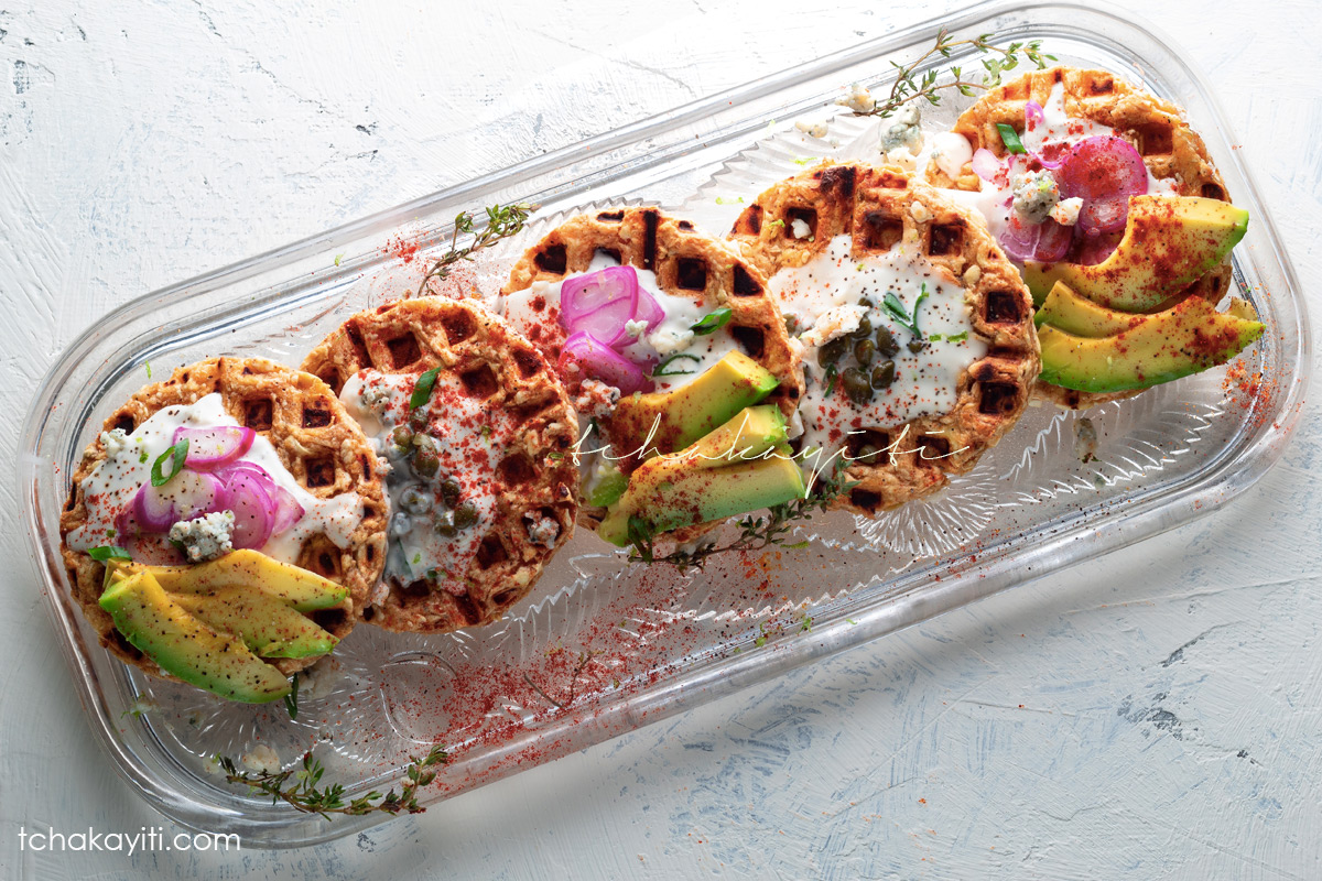 Topped with avocado, capers, gorgonzola cheese and shallots, a waffled breadfruit will elevate your brunch table.   tchakayiti.com