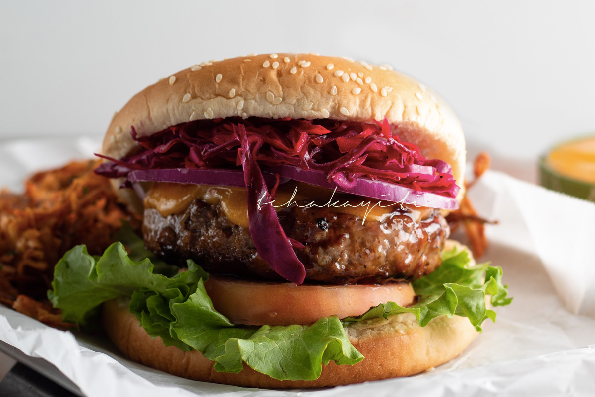 Pineapple glazed burger with a spicy mango ketchup make for a summer flavored burger with a Caribbean twist.   tchakayiti.com