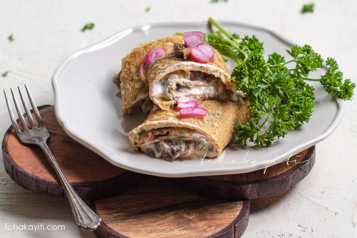 Omelette roll stuffed with aransò, salted smoked herring, sharp cheddar, sour cream and pickled shallots. | tchakayiti.com